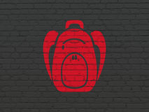 Tourism concept: Backpack on wall background Stock Image