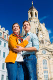 Tourism - couple at Frauenkirche in Dresden Stock Images