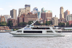Tourism cruise boat in the New York Harbor with the Brooklyn sky Royalty Free Stock Image