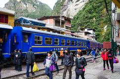 Tourism in Cusco - Peru, 2015. Aguas Calientes, Peru - December 31, 2015 : Peru Rail train arriving at Machu Picchu Station in Aguas Calientes stock image
