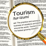 Tourism Definition Magnifier Showing Traveling Vacations And Holidays stock photography