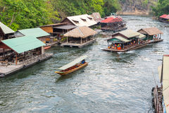 Tourism on the floating house rafting at the river Kwai Royalty Free Stock Photo