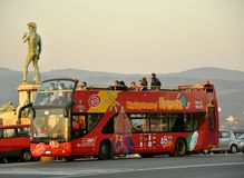 Tourism in Florence, Italy. Double decker touristic red bus in the piazzale Michelangelo in Florence city, Italy. hop on hop off car with tourists .tour bus royalty free stock images
