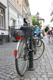 Tourism germany street. A bike chained to a post in a cobbled street in Dusseldorf, Germany Stock Photo