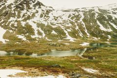 Melting snow in norwegian mountains Royalty Free Stock Images