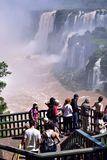 Tourism at the magnificent Iguazu Waterfalls with sunny skies stock image