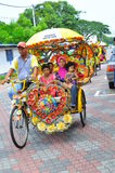 Tourism Malaysia - trishaw and passenger stock images