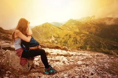 Tourism in mountains. Female tourist rest on the mountain path. Nature in mountains image Stock Photo