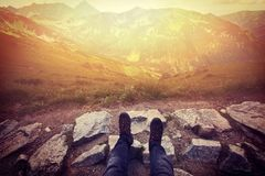 Tourism in mountains. Tourist rest on the mountain path Royalty Free Stock Image