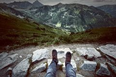 Tourism in mountains. Tourist rest on the mountain path. Retro vintage picture Royalty Free Stock Image