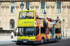 Tourism in Paris. PARIS, FRANCE - OCT 12, 2010 - L'Open Tour bus on the streets of Paris Royalty Free Stock Images