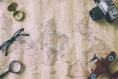 Tourism planning and apparel needed for the trip on old map. Tra. Tourism planning and apparel equipment needed for the trip on old map. Travel accessories Royalty Free Stock Photography