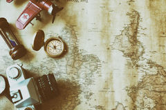 Tourism planning and apparel needed for the trip on old map. Tra. Tourism planning and apparel equipment needed for the trip on old map. Travel accessories Stock Photos
