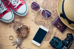 Tourism planning and equipment needed for the trip on map. Stock Image
