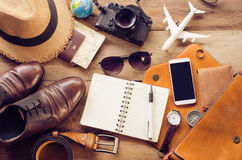 Tourism planning and equipment needed for the trip on wooden flo Royalty Free Stock Photography