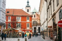 Prague, December 24, 2017: Tourism in Prague. People walk along the street in the city, look at the sights and look for. Tourism in Prague. People walk along the Stock Photo