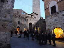 Tourism in San Gimignano. Old city of beautiful Toscana Royalty Free Stock Photography