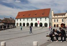 Tourism in Sibiu, Romania. Tourists walking in Sibiu, Romania Royalty Free Stock Images