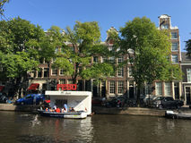 Tourism at a snack corner in the canals of Amsterdam Royalty Free Stock Photo