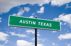 Tourism Street Sign with blue clouds. Informational sign travel tourism to Austin Texas transportation highway downtown Royalty Free Stock Photography