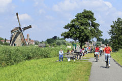 Tourism on a summer day, Kinderdijk, Holland Royalty Free Stock Image