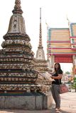 Tourism Temples in Thailand. Women are a map and extended walks in the temple Royalty Free Stock Images