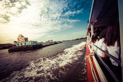 Tourism and travel in Bangkok by the Chao Phraya Express Boat. Stock Photography
