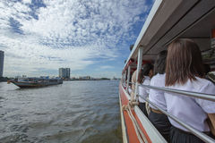 Tourism and travel in Bangkok by the Chao Phraya Express Boat. Royalty Free Stock Photo