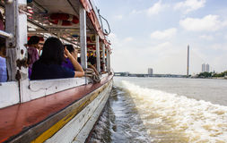 The Tourism and travel in Bangkok by the Chao Phraya Express Boat. Stock Photos
