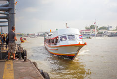 Tourism and travel in Bangkok by the Chao Phraya Express Boat. Royalty Free Stock Photos
