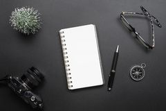 Tourism, travel, and new year business management planning concept. Office desk table with notepad, camera and supplies. Top view stock photography