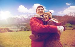 Happy couple hugging over alps mountains Royalty Free Stock Photo