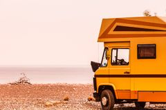 Camper car on beach. Travel. Tourism vacation and travel. Camper van on beach sea shore in summer time, Greece Royalty Free Stock Photography