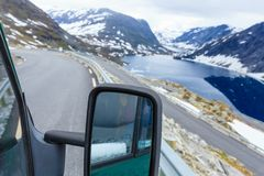 Camper car in norwegian mountains. Tourism vacation and travel. Camper van on road in mountains landscape in Norway Stock Photography