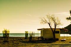 Caravan trailer on sunny beach Royalty Free Stock Photo