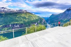Tourist looking at Geirangerfjord from Flydasjuvet viewpoint Norway Royalty Free Stock Photos