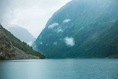 Mountains and fjord Sognefjord in Norway, Scandinavia. Tourism vacation and travel. Mountains and fjord Sognefjord in Norway, Scandinavia. Misty foggy day stock images