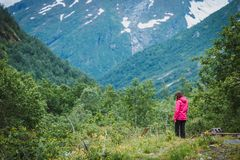 Tourist woman enjoying mountains landscape in Norway. Royalty Free Stock Photography