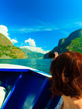 Tourism. Woman with camera on ship, fjord in Norway. Stock Image