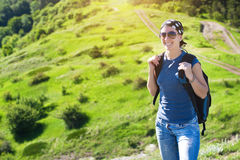 Tourism. young woman hiking in the mountains Stock Photo