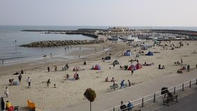 Tourisst and visitors Lyme Regis beach Dorset England UK in Lyme Bay stock video