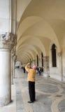 Tourist. Venetian tourist taking a photo royalty free stock image