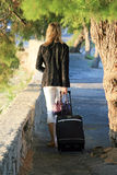 Tourist. Young tourist women walking to the street with baggage Royalty Free Stock Photos