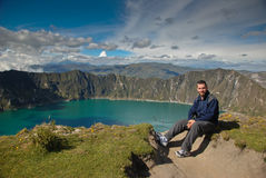 Tourist above a blue lake Royalty Free Stock Photos