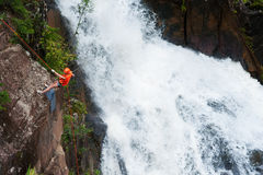 Tourist abseils into Datanla waterfall in Vietnam Royalty Free Stock Image