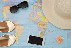 Tourist accessories on the world map. royalty free stock image