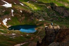Tourist admires view from California Pass towards lake Como and stock photos