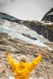 Tourist admiring Boyabreen Glacier in Norway Royalty Free Stock Photo