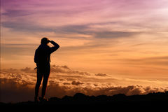 Tourist admiring breathtaking sunset views from the Mauna Kea, a dormant volcano on the island of Hawaii. The peak of Mauna Kea peak is the highest point in stock image