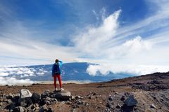 Tourist admiring breathtaking view of Mauna Loa volcano on the Big Island of Hawaii. The largest subaerial volcano in both mass and volume, Mauna Loa has been Stock Photography